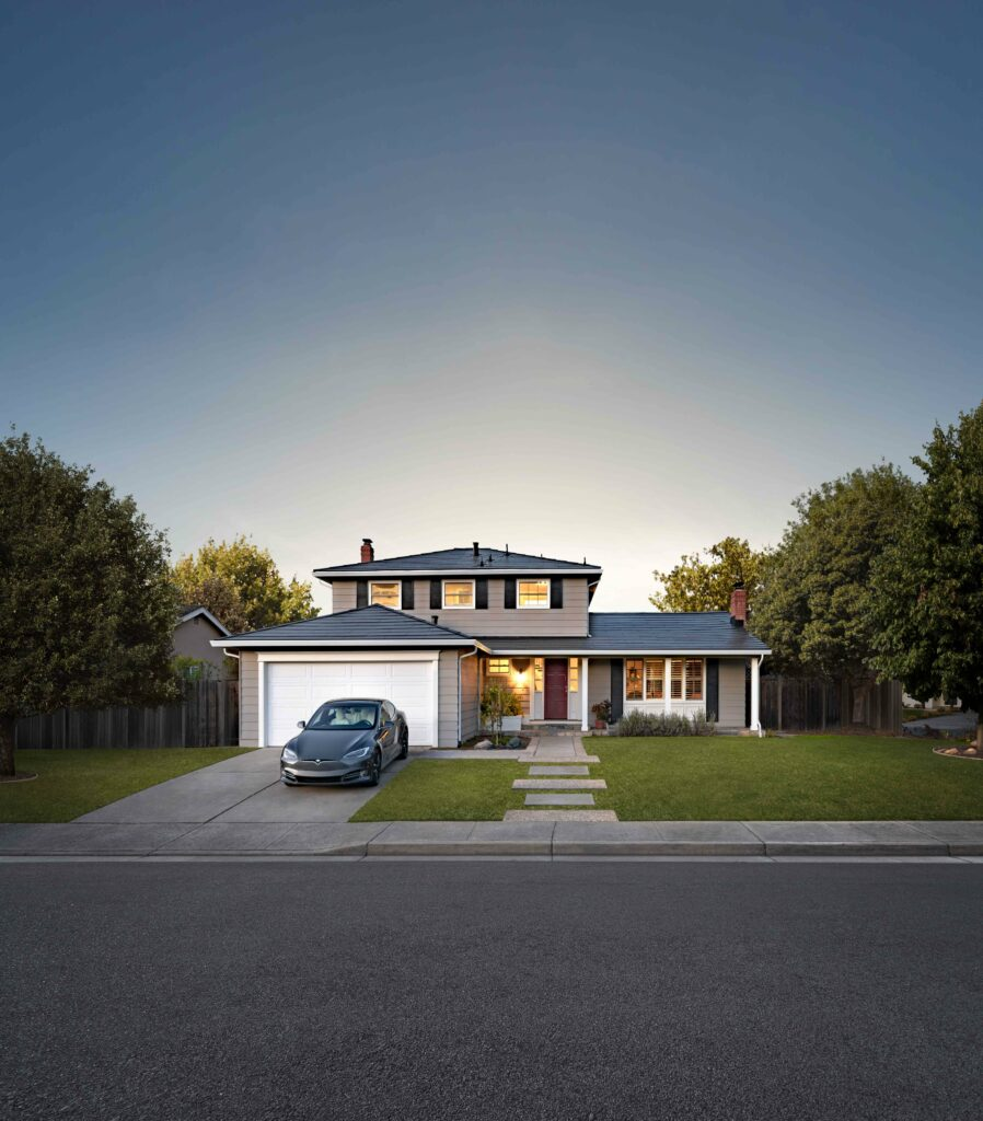 House and garage with Tesla solar roof